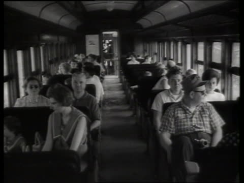 vídeos de stock e filmes b-roll de b/w people riding in train / sound - locomotiva a vapor