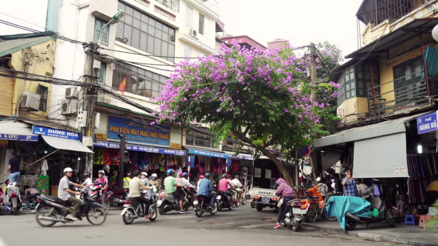 ws people riding mopeds on road in city / hanoi, vietnam - hanoi stock videos and b-roll footage