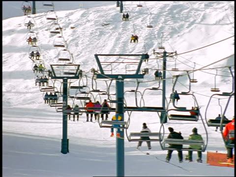 people riding ski lifts - ski holiday stock videos & royalty-free footage
