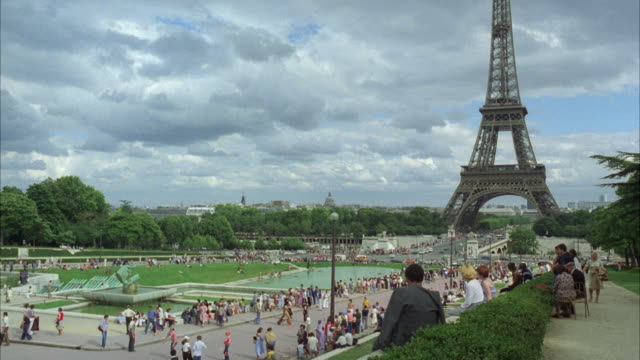 ms people roaming and enjoying near eiffel tower - eiffel tower paris stock videos & royalty-free footage