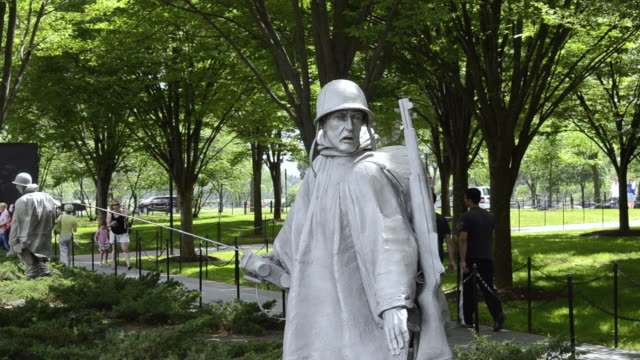 MS People roaming at statues in platoon at new korean war veterans memorial with bronze statues in Mall / Washington DC, Washington District of Columbia, United States