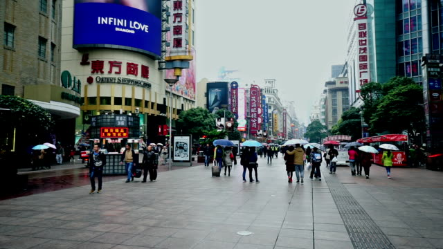 people roaming at the nanjing road shopping street in shanghai, china - chinese currency stock videos & royalty-free footage