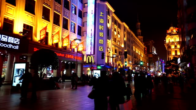 People roaming at the Nanjing Road shopping street in the evening, Shanghai, China