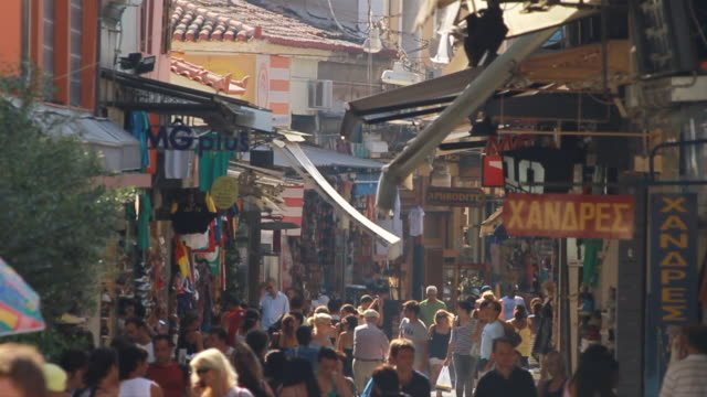 ms slo mo people roaming in flea market at city / athens, greece - athens greece stock videos & royalty-free footage