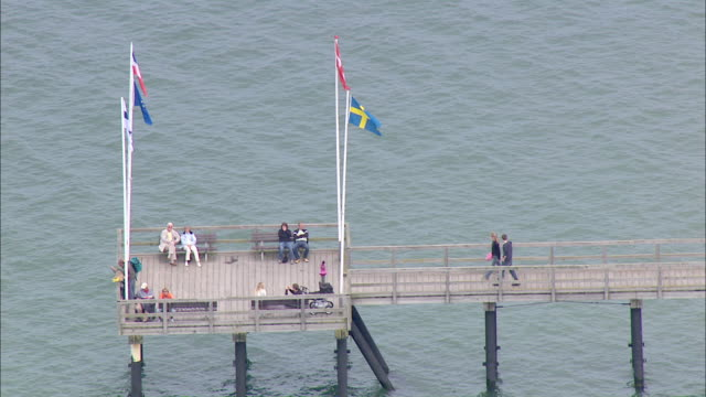 aerial ms people roaming on jetty  / holstein switzerland, schleswig-holstein, germany - schleswig holstein stock videos & royalty-free footage