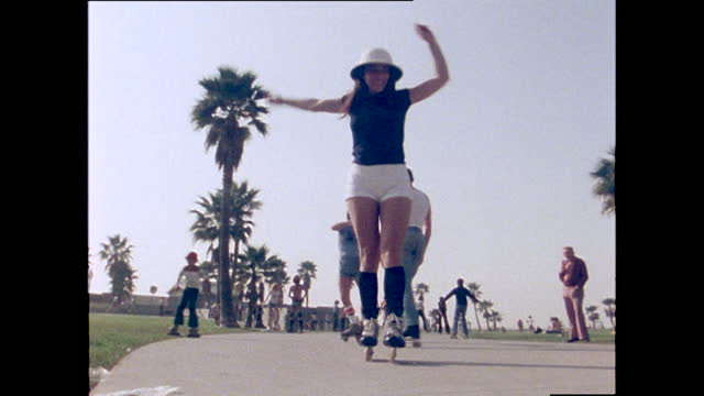 people roller skate, skateboard, cycle and play sports, venice beach; 1978 - retro style stock videos & royalty-free footage