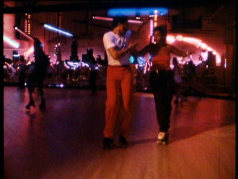 1982 People roller skating at disco roller rink