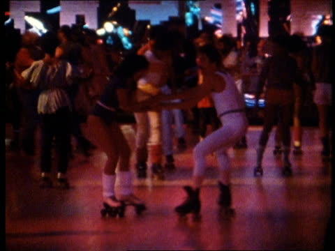 1982 people roller skating at disco roller rink - 1980~1989年点の映像素材/bロール
