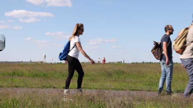 people rollerblade and relax at tempelhofer feld public park during the coronavirus pandemic on may 30, 2021 in berlin, germany. while the pandemic... - public park stock videos & royalty-free footage