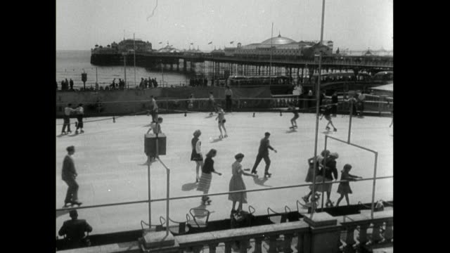 people rollerskating on a rink on brighton seafront; 1950 - 1950 stock videos & royalty-free footage