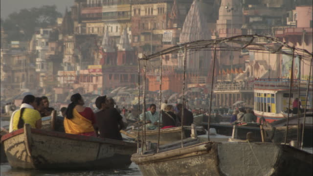 People row boats on Ganges, Varanasi Available in HD.