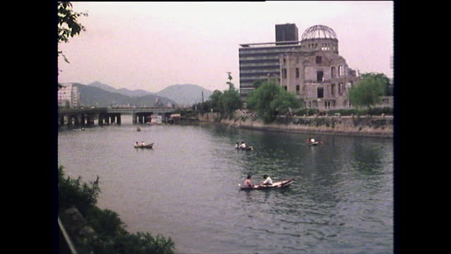 people row on river by hiroshima peace memorial; 1975 - nuclear bomb stock videos & royalty-free footage
