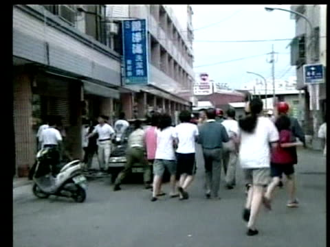 people run away from collapsing building following earthquake chi chi 23 september 1999 - taiwan stock videos & royalty-free footage