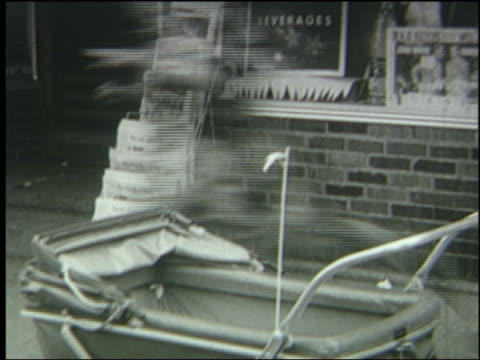 b/w 1951 people run past baby carriage on sidewalk during air raid - 1951 stock videos & royalty-free footage