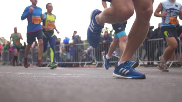 people running at bristol half marathon 2017 close up of feet - charity benefit stock videos & royalty-free footage