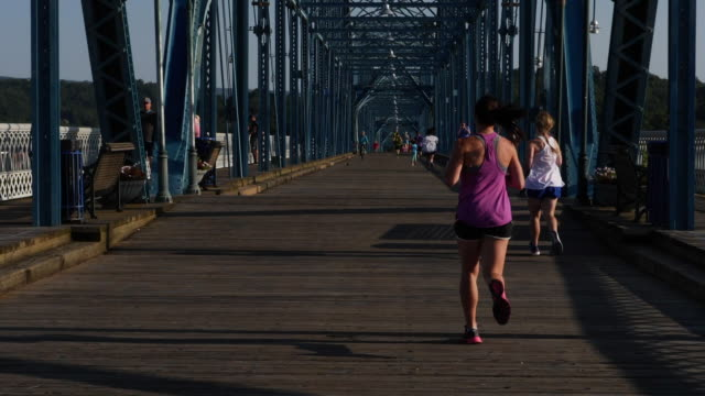 people running crossing the bridge in chattanooga - chattanooga stock videos and b-roll footage
