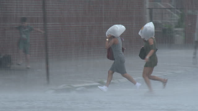 People Running For Cover In A Heavy Rain Storm