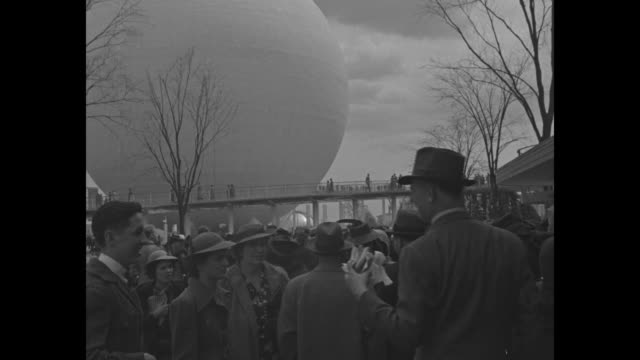 people running from gate as 1939 new york world's fair opens / newsreel cameras cameramen / pov large crowd / man holding fair pamphlets / high angle... - flushing meadows corona park stock videos and b-roll footage