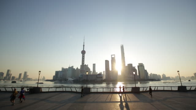 WS people running in the morning on The Bund, Shanghai, China.