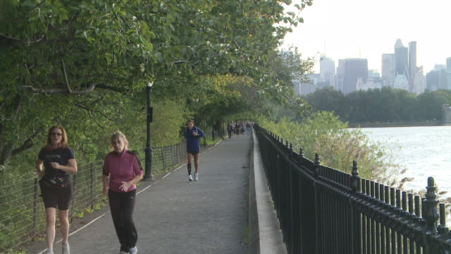 ms people running on path of jacqueline onassis reservoir in central park / new york, new york, united states - central park reservoir stock videos and b-roll footage