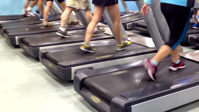 people running on treadmills - exercise machine stock videos & royalty-free footage