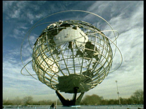 people rush around 'unisphere' sculpture, queens - flushing meadows corona park stock videos and b-roll footage