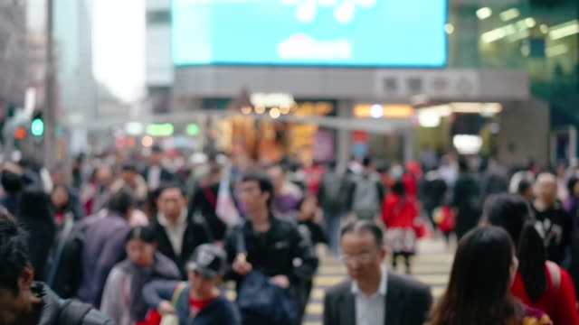 people rush in hong kong, zebra crossing - chinese ethnicity stock videos & royalty-free footage