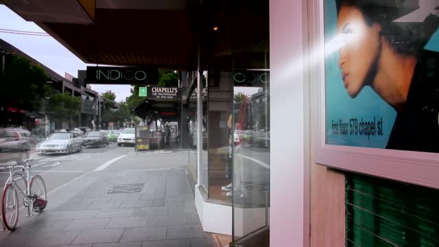MS T/L People rushing along Chapel Street shopping precinct / Melbourne, Victoria, Australia
