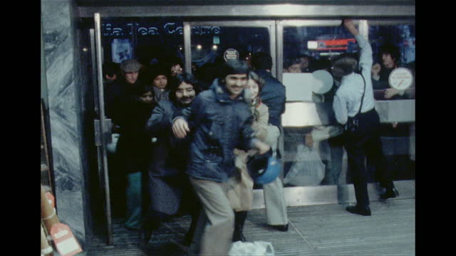 people rushing into debenhams department store on oxford street, at the start of the boxing day sales, 1978 - sales occupation stock videos & royalty-free footage