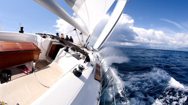 slo mo people sailing on rough sea - yacht stock videos & royalty-free footage