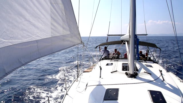 stockvideo's en b-roll-footage met slo mo people sailing on the sailboat - jachtvaren