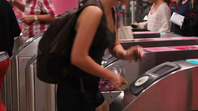 people scanning subway pass at the ticket gate in singapore - boundary stock videos & royalty-free footage