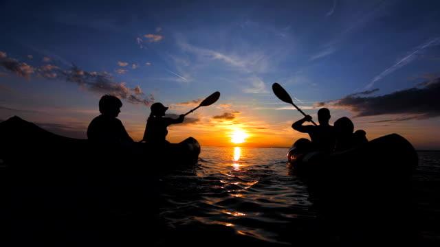 TS People Sea Kayaking At Sunset
