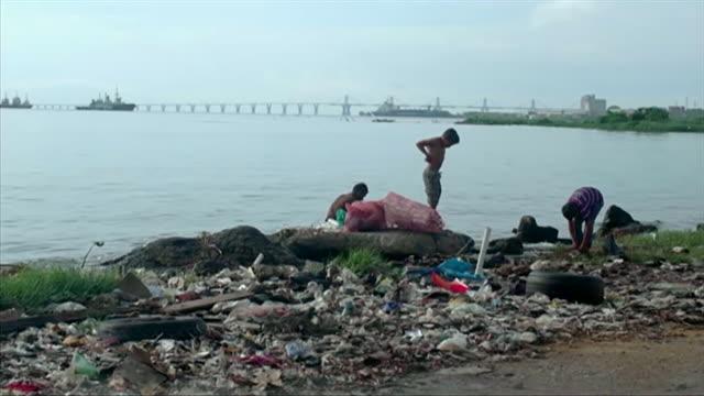 people searching for food in rubbish piles in caracas, venezuela - caracas stock videos & royalty-free footage
