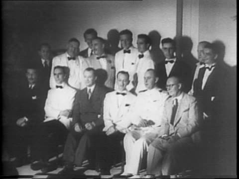 people seated at tables at the national headliners club dinner in atlantic city / man speaking to the diners / group of award winners posing for... - 1942 stock videos & royalty-free footage