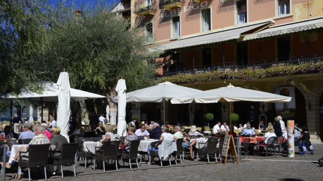 ms people seating in restaurant / torri del benaco, veneto, verona, italy - service stock videos & royalty-free footage