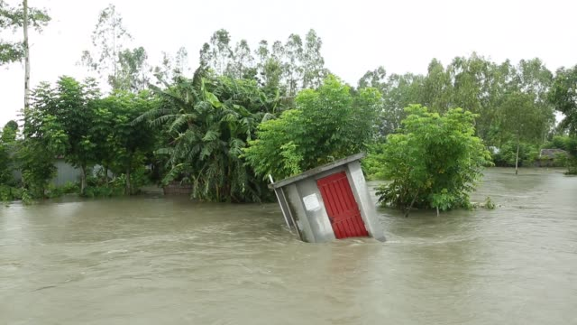 people seen near their near submerged houses during flood in the northern part of bangladesh heavy monsoon rains have unleashed landslides and floods... - natural phenomenon stock videos & royalty-free footage