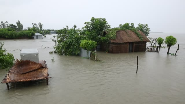 people seen near their near submerged houses during flood in the northern part of bangladesh heavy monsoon rains have unleashed landslides and floods... - bangladesch stock-videos und b-roll-filmmaterial
