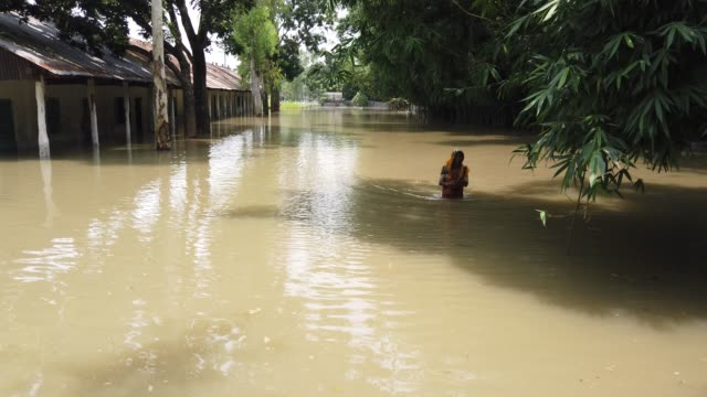 people seen near their near submerged houses during flood in the northern part of bangladesh. heavy monsoon rains have unleashed landslides and... - monsoon stock videos & royalty-free footage