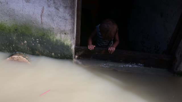 people seen on street during tideup at agrabad area in chittagong bangladesh on july 27 2017 every day agrabad area goes under water 45 feet during... - bangladesch stock-videos und b-roll-filmmaterial