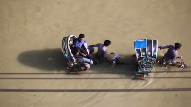People seen on street during tideup at Agrabad area in Chittagong Bangladesh on July 27 2017 Every day Agrabad area goes under water 45 feet during...
