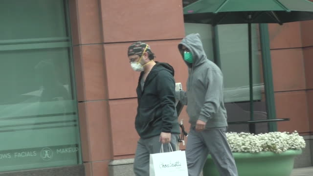 people seen wearing masks amid coronavirus fears in beverly hills in celebrity sightings in los angeles - beverly hills california stock videos & royalty-free footage