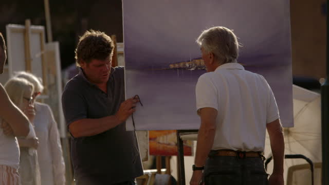 people selling artwork pack up for the day, st-tropez - var stock videos & royalty-free footage