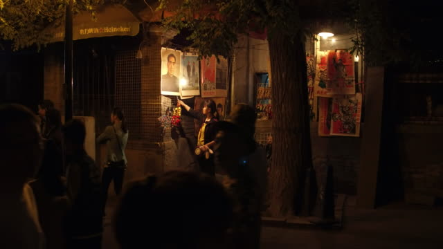 People sells portraits of Mao Tsetung and Chou EnLai in famous Houhai Area on May 6 2017 in Beijing China