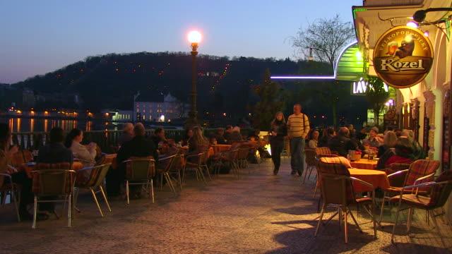 MS People setting outside of restaurant near charles bridge / Prague, Hlavni mesto Praha, Czech Republic