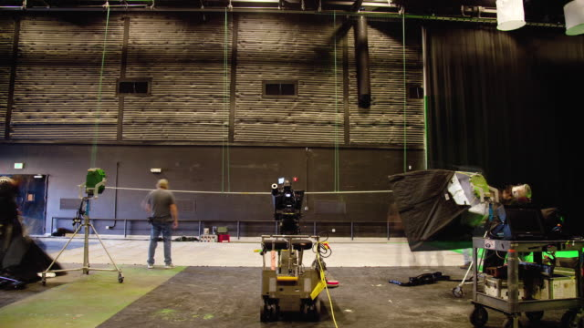 T/L WS People setting up camera and equipment in film studio / Los Angeles, California, USA