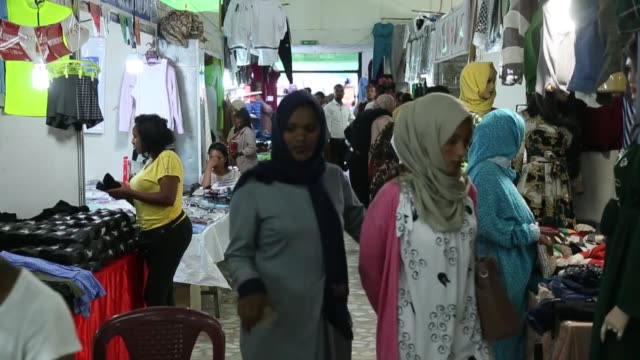 people shop at an expo organized for the upcoming eid al-fitr during the muslim holy month of ramadan on may 30, 2019 in addis ababa, ethiopia. eid... - ethiopia stock videos & royalty-free footage