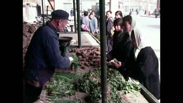 people shop for food at market stall in beijing; 1973 - maoism stock videos & royalty-free footage