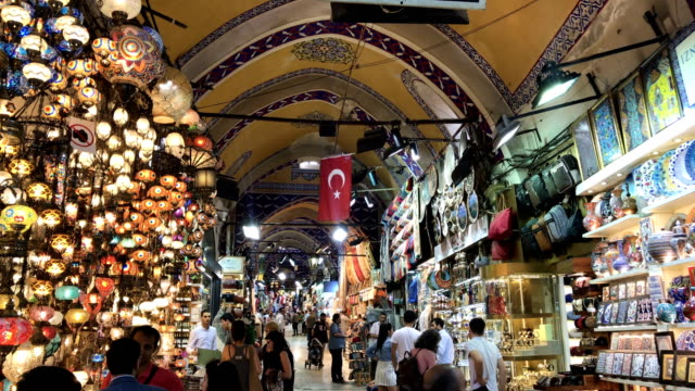 people shop in istanbul's famous grand bazaar on may 30 2018 in istanbul turkey fears are growing that turkey's economy is heading into crisis as the... - イスタンブール グランドバザール点の映像素材/bロール
