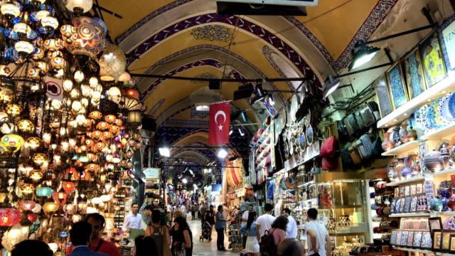 stockvideo's en b-roll-footage met people shop in istanbul's famous grand bazaar on may 30, 2018 in istanbul, turkey. fears are growing that turkey's economy is heading into crisis as... - grote bazaar van istanboel istanboel